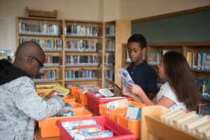 Students selecting books in a school library